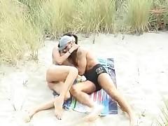 Beach couple with a friend