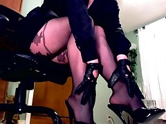 Femdom In Pantyhose Teases With A Leather Paddle