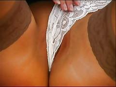 Horny teacher rubs pussy in classroom
