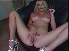 Blonde rubbing and fingering her pussy