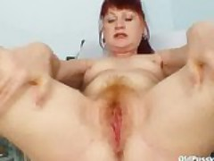 Mature old redhead Olga visiting her gyno doctor for proper real mature pus