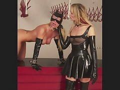 Mistress Domina in leather and in latex