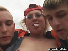 Two dudes pick up old bitch and screw her hard